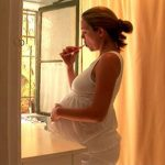 pregnant woman brushing teeth and concerned about Oral Care During Pregnancy